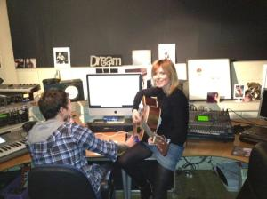 Geri in studio playing guitar